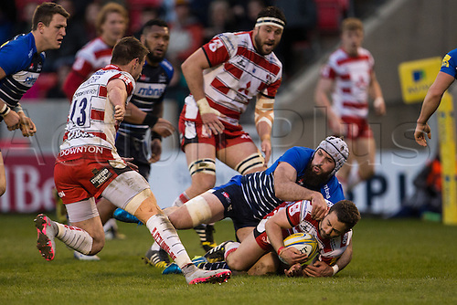 29.04.2016. AJ Bell Stadium, Salford, England. Aviva Premiership Sale Sharks versus Gloucester Rugby. Gloucester Rugby scrum half Greig Laidlaw is tackled by Sale Sharks lock Bryn Evans.