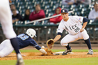 Rice Owls first baseman Blake Fox #26 catches an attempted pickoff during the NCAA baseball game against the North Carolina Tar Heels on March 1st, 2013 at Minute Maid Park in Houston, Texas. North Carolina defeated Rice 2-1. (Andrew Woolley/Four Seam Images).