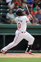 Right fielder Franklin Guzman (10) of the Greenville Drive bats in a game against the Asheville Tourists on Sunday, July 20, 2014, at Fluor Field at the West End in Greenville, South Carolina. Asheville won game two of a doubleheader, 3-2. (Tom Priddy/Four Seam Images)