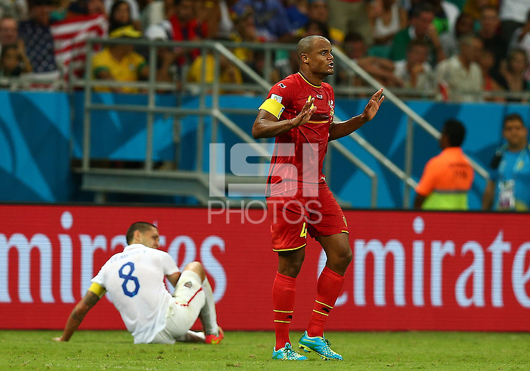 Vincent Kompany of Belgium gestures after fouling Clint Dempsey of USA