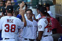 Mesa Solar Sox catcher Sean Ochinko (11) is congratulated in the dugout after hitting a home run during an Arizona Fall League game against the Surprise Saguaros on October 17, 2014 at Cubs Park in Mesa, Arizona.  Mesa defeated Mesa 5-3.  (Mike Janes/Four Seam Images)