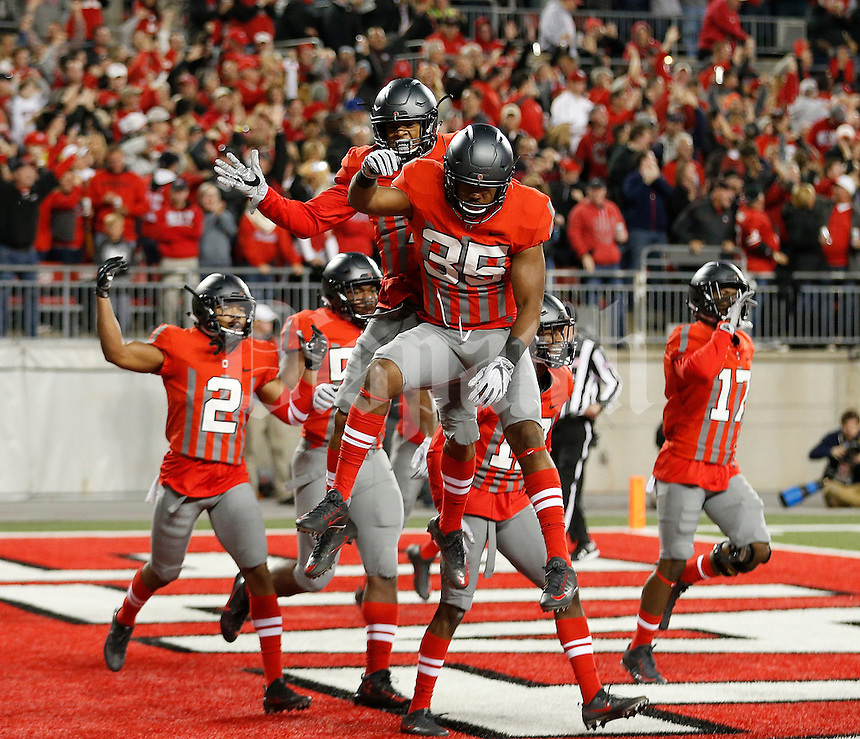Ohio State Buckeyes cornerback Damon Webb (7) celebrates his interception for a touchdown with Ohio State Buckeyes safety Erick Smith (34) during first quarter of the NCAA football game between the Ohio State Buckeyes and the Nebraska Cornhuskers at Ohio Stadium in Columbus on Saturday, November 5, 2016. (Columbus Dispatch photo by Jonathan Quilter)