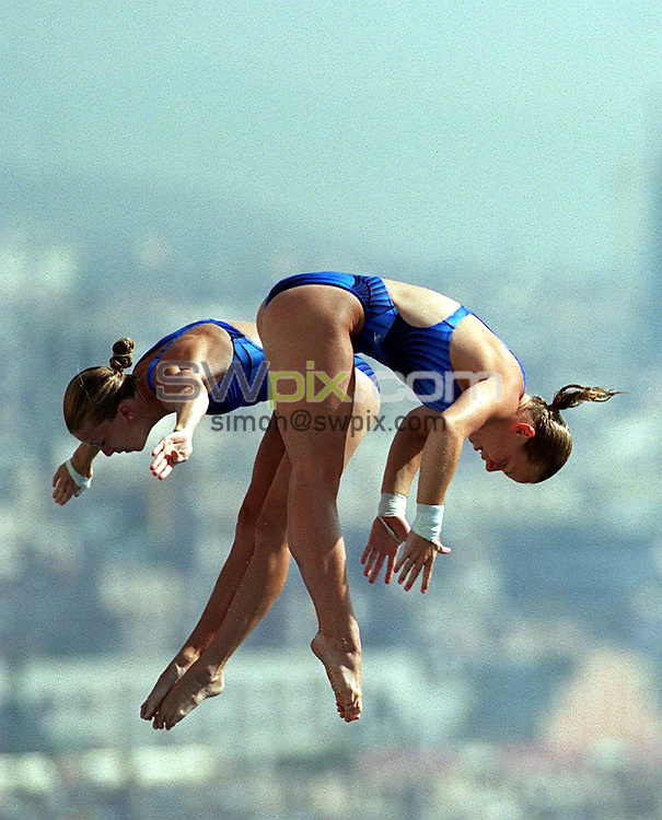 Pix: Matthew Lewis/SWpix.com. Diving. 10th Fina World Championships 2003, Barcelona. 20/07/2003...COPYRIGHT PICTURE>>SIMON WILKINSON>>01943 436649>>..United States Laura Wilkinson and Belinda Viola compete in the Womens 10m Synchronised Highboard heats.