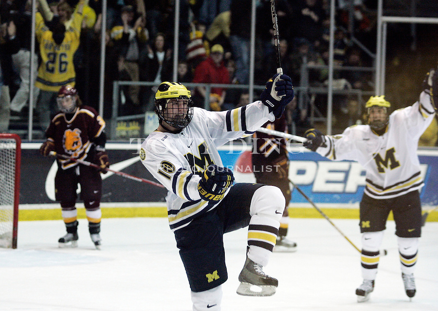 10 March 2006: Michigan forward Travis Turnbull (10) celebrates his game winning goal during the third period of a CCHA Quarterfinal-round ice hockey game between Ferris State and No. 14 Michigan at Yost Ice Arena in Ann Arbor, MI. Michigan won 6-4.