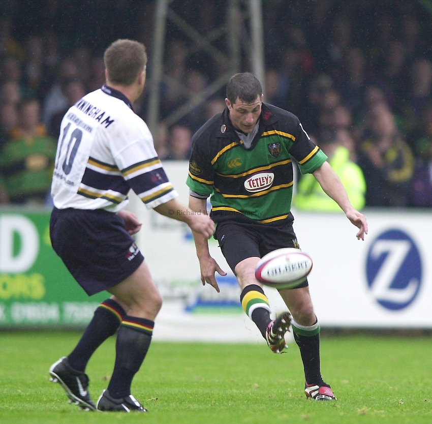 Photo. Richard Lane. .Northampton v London Irish. Zurich Premiership. 26/8/2000..Paul Grayson clears as Jarrord Cunningham challenges.
