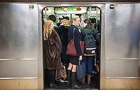 Passengers crowd into a subway train with their backpacks and totes in New York on Thursday, November 26, 2014. (© Richard B. Levine)