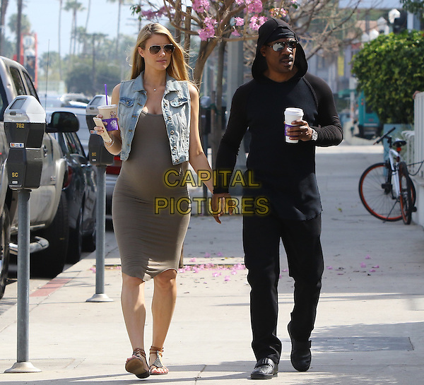 STUDIO CITY, CA - MARCH 2: Eddie Murphy and girlfriend Paige Butcher taking a walk after getting coffee at The Coffee Bean and Tea Leaf in Studio City, California on March 2, 2016.<br /> CAP/MPI/JM<br /> &copy;JM/MPI/Capital Pictures