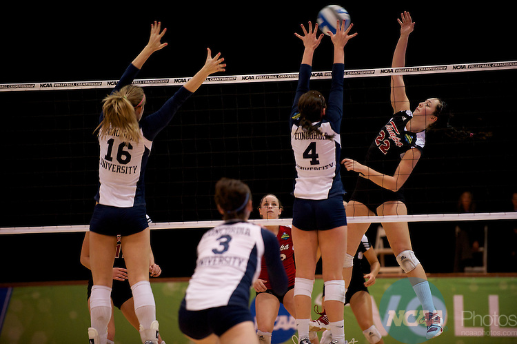 04 DEC 2010:  Jessica Yingling (22) of Tampa spikes the ball past the Concordia St. Paul defense during the Division II Women's Volleyball Championship held at Knights Hall on the Bellarmine campus in Louisville, KY.  Concordia St. Paul won over Tampa 3-1. Josh Duplechian/NCAA Photos