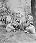 GPHR 45/0042:  A group of six male students gathered on Main Quad with the Main Building in the background, 1948-1949..This photo was published in the 1949 Dome yearbook, page 15..Image from the University of Notre Dame Archives.