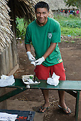 Xingu Indigenous Park, Mato Grosso State, Brazil. Nursing assistant Tawaiu Yudja preparing his dental equipment.