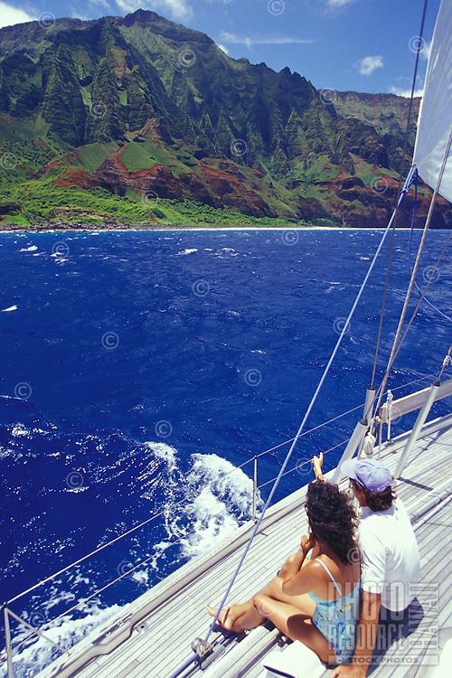 Couple sailing on Kauai's Na Pali Coast