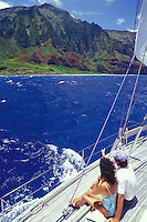 Couple sailing on Kauai's Na Pali Coast