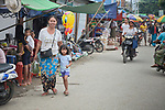 People walk through the Tahan Market in Kalay, a town in Myanmar. This market is located in Tahan, the largely ethnic Chin section of the town.