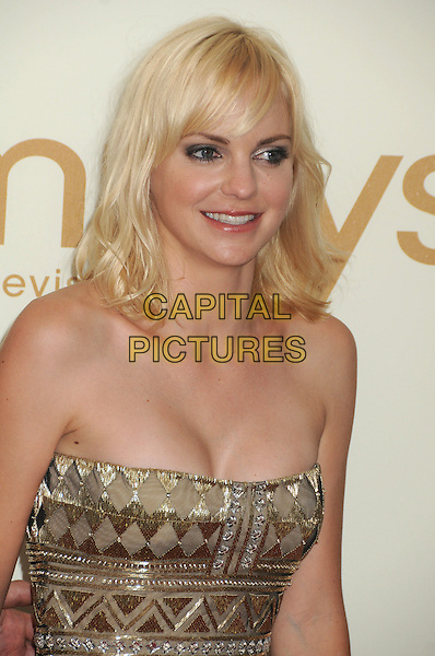 Anna Faris.63rd Primetime Emmy Awards held at Nokia Theatre L.A. Live. Los Angeles, California, USA. .18th September 2011.emmys half length silver gold sequins sequined dress strapless cleavage.CAP/ADM/BP.©Byron Purvis/AdMedia/Capital Pictures.