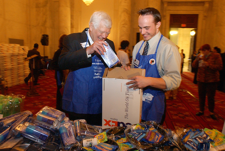 Rep. Jim McDermott, D-Wash., helps Paul Laplante of Orphan Foundation of America (OFA), make care packages for 2,500 college students, that have aged out of foster care as part of National Care Package Day on Capitol Hill.  The OFA event was designed to draw attention to the needs of young people who leave foster care without any emotional or financial support.