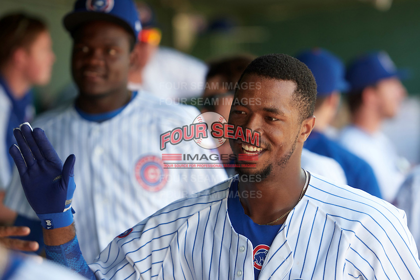 South Bend Cubs left fielder Eloy Jimenez (27) high fives teammates in the dugout after hitting a home run during the second game of a doubleheader against the Peoria Chiefs on July 25, 2016 at Four Winds Field in South Bend, Indiana.  South Bend defeated Peoria 9-2.  (Mike Janes/Four Seam Images)