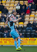 Thierry Audel of Notts County beats Garry Thompson of Wycombe Wanderers in the air during the Sky Bet League 2 match between Notts County and Wycombe Wanderers at Meadow Lane, Nottingham, England on 28 March 2016. Photo by Andy Rowland.