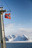 SVALBARD, Longyearban, The norwegian flag hoisted on the MS Origo while sailing out of port of Longyearban