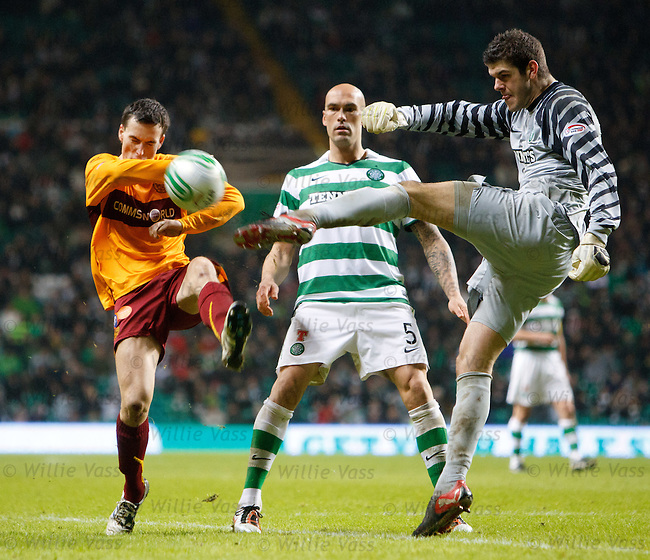 Fraser Forster hoofs clear of Alan Gow as Daniel Majstorovic watches on