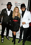 LOS ANGELES, CA. - February 05: (L-R) Singers will.i.am, Fergie, and Taboo of The Black Eyed Peas arrive at the Black Eyed Peas Peapod Foundation benefit concert presented by Adobe Youth Voices inside the Conga Room at the Nokia Theatre L.A. Live on February 5, 2009 in Los Angeles, California.