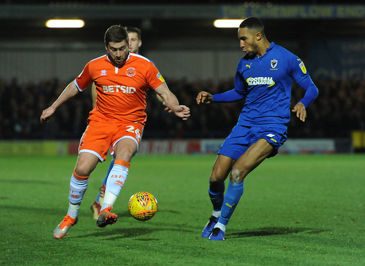 Blackpool's Steve Davies under pressure from AFC Wimbledon's Terell Thomas<br /> <br /> Photographer Kevin Barnes/CameraSport<br /> <br /> The EFL Sky Bet League One - AFC Wimbledon v Blackpool - Saturday 29th December 2018 - Kingsmeadow Stadium - London<br /> <br /> World Copyright © 2018 CameraSport. All rights reserved. 43 Linden Ave. Countesthorpe. Leicester. England. LE8 5PG - Tel: +44 (0) 116 277 4147 - admin@camerasport.com - www.camerasport.com