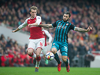 Southampton's Charlie Austin and Arsenal's Rob Holding<br /> during the EPL - Premier League match between Arsenal and Southampton at the Emirates Stadium, London, England on 8 April 2018. Photo by Andrew Aleksiejczuk / PRiME Media Images.