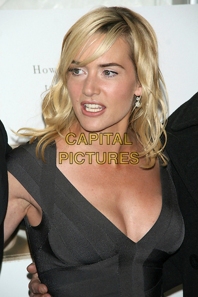 "KATE WINSLET .New York Premiere of ""The Reader"" at the Ziegfeld Theater, New York City, New York, USA, December 3rd 2008..portrait headshot black grey gray Herve Leger bandage body con bodycon dress tight fitted low cut cleavage diamond earrings side swept hair fringe blonde .CAP/LNC/TOM.©LNC/Capital Pictures"