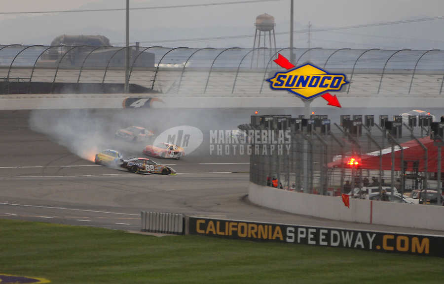 Feb 25, 2007; Fontana, CA, USA; Nascar Nextel Cup Series drivers Ricky Rudd (88) and Bobby Labonte (43) crash during the Auto Club 500 at California Speedway. Mandatory Credit: Mark J. Rebilas