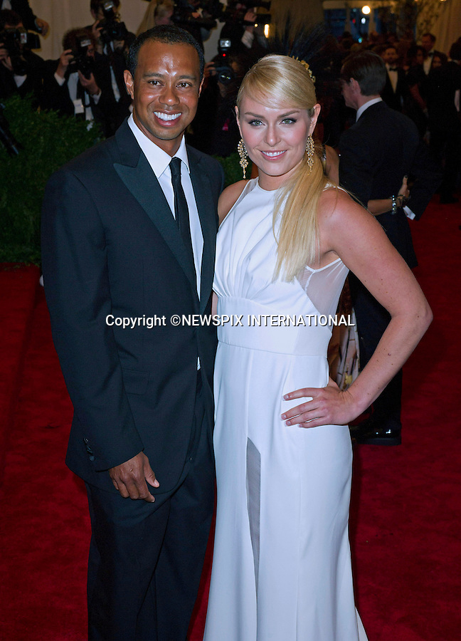"""TIGER WOODS AND LINDSEY VONN.attend the Costume Institute Gala at the Metropolitan Museum of Art, New York.The event is considered the Oscars of the Fashion world_06/05/2013.Mandatory credit photo:©Dias/NEWSPIX INTERNATIONAL..**ALL FEES PAYABLE TO: """"NEWSPIX INTERNATIONAL""""**..PHOTO CREDIT MANDATORY!!: NEWSPIX INTERNATIONAL(Failure to credit will incur a surcharge of 100% of reproduction fees)..IMMEDIATE CONFIRMATION OF USAGE REQUIRED:.Newspix International, 31 Chinnery Hill, Bishop's Stortford, ENGLAND CM23 3PS.Tel:+441279 324672  ; Fax: +441279656877.Mobile:  0777568 1153.e-mail: info@newspixinternational.co.uk"""