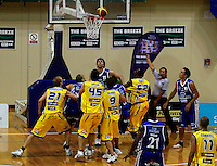 Kevin Owens (centre) waits for the ball as it teeters on the rim during the NBL Basketball match between Wellington Saints and Otago Nuggets at TSB Bank Arena, Wellington, New Zealand on Sunday, 30 March 2008. Photo: Dave Lintott / lintottphoto.co.nz