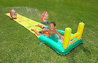Boy on water slide.