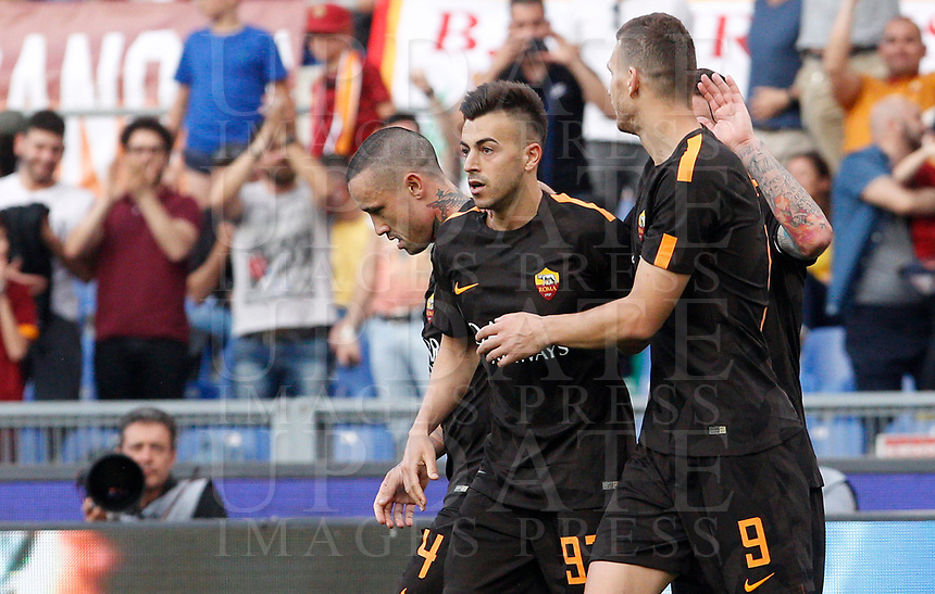 Roma s Stephan El Shaarawy, center, celebrates with his teammates Radja Nainggolan, left, and Edin Dzeko after scoring during the Italian Serie A football match between Roma and Chievo Verona at Rome's Olympic stadium, 28 April 2018.<br /> UPDATE IMAGES PRESS/Riccardo De Luca