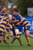 Savelio Ropati gets tackled by Aloisio Maasi and Brad Murison. Counties Manukau Premier Club Rugby game between Patumahoe and Ardmore Marist, played at Patumahoe on Saturday July 9th 2016.<br /> Ardmore Marist won the game 33 - 24 after leading 18 - 12 at halftime. Photo by Richard Spranger.