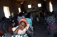 MPHANDULA, MALAWI - AUGUST 20: An unidentified child with her mother during a church service at the African Abraham Church on August 20, 2006 in Mphandula village, about 30 miles outside Lilongwe, Malawi. Mphandula is a poor village in Malawi, without electricity or clean water. Nobody owns a car or a mobile phone. Most people live on farming. About 7000 people reside in the village and the chief estimates that there are about five-hundred orphans. Many have been affected by HIV/Aids and many of the children are orphaned. A foundation started by Madonna has decided to build an orphan center in the village through Consol Homes, a Malawi based organization. Raising Malawi is investing about 3 million dollars in the project and Madonna is scheduled to visit the village in October 2006. Malawi is a small landlocked country in Southern Africa without any natural resources. Many people are affected by the Aids epidemic. Malawi is one of the poorest countries in the world and has about 1 million orphaned children. (Photo by Per-Anders Pettersson)