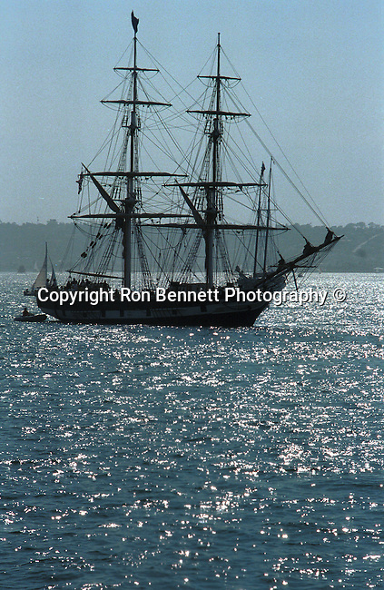 Silhouette of anchored Schooner America  anchored in San Diego bay California, Schooner America, schooner, San Diego Bay California, tall ship, full rigged ship named after the Greek goddess of music, tall ship is large traditionally rigged sailing vessel, California Fine Art Photography by Ron Bennett,