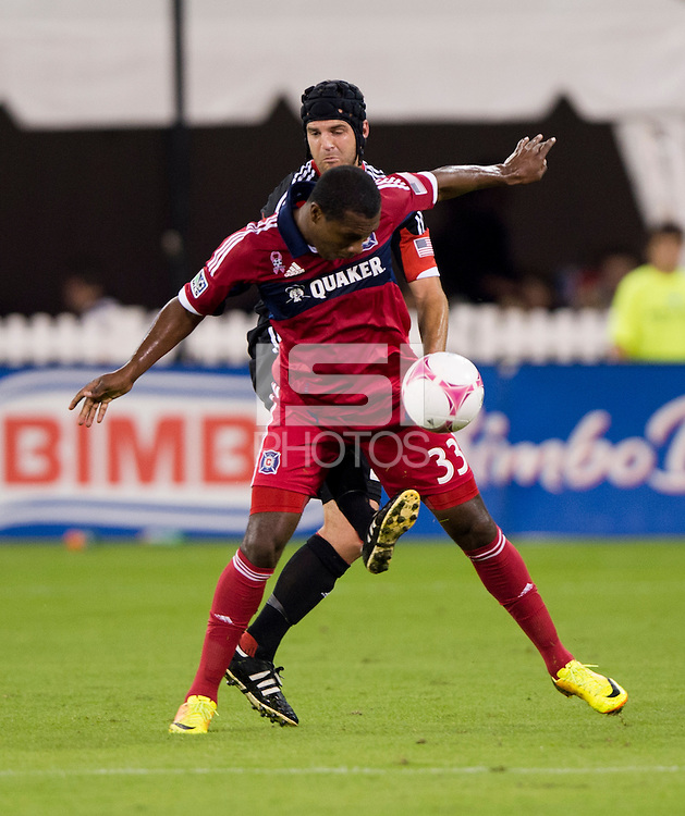 Juan Luis Anangono (33) of the Chicago Fire has the ball cleared away from him by Daniel Woolard (21) of D.C. United during a Major League Soccer game at RFK Stadium in Washington, DC.  The Chicago Fire defeated D.C. United, 3-0.