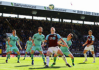 Burnley's Ashley Barnes shields the ball from Arsenal's Stephan Lichtsteiner and Shkodran Mustafi<br /> <br /> Photographer Alex Dodd/CameraSport<br /> <br /> The Premier League - Burnley v Arsenal - Sunday 12th May 2019 - Turf Moor - Burnley<br /> <br /> World Copyright &copy; 2019 CameraSport. All rights reserved. 43 Linden Ave. Countesthorpe. Leicester. England. LE8 5PG - Tel: +44 (0) 116 277 4147 - admin@camerasport.com - www.camerasport.com