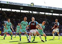 Burnley's Ashley Barnes shields the ball from Arsenal's Stephan Lichtsteiner and Shkodran Mustafi<br /> <br /> Photographer Alex Dodd/CameraSport<br /> <br /> The Premier League - Burnley v Arsenal - Sunday 12th May 2019 - Turf Moor - Burnley<br /> <br /> World Copyright © 2019 CameraSport. All rights reserved. 43 Linden Ave. Countesthorpe. Leicester. England. LE8 5PG - Tel: +44 (0) 116 277 4147 - admin@camerasport.com - www.camerasport.com