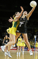 Silver Ferns Temepara George competes with Natalie von Bertouch during the netball test match between the Silver Ferns v Australia played at the Sydney Superdome, Sydney Australia, 29th June 2005. The Silver Ferns won 50-43. ©Michael Bradley