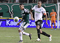 PALMIRA - COLOMBIA, 21-08-2019: Carlos Rodriguez del Cali disputa el balón con Alexis Henriquez de Nacional durante partido entre Deportivo Cali y Atlético Nacional por la fecha 7 de la Liga Águila II 2019 jugado en el estadio Deportivo Cali de la ciudad de Palmira. / Carlos Rodriguez of Cali vies for the ball with Alexis Henriquez of Nacional during match between Deportivo Cali and Atletico Nacional for the date 7 as part Aguila League II 2019 played at Deportivo Cali stadium in Palmira city. Photo: VizzorImage / Gabriel Aponte / Staff