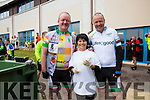 Mick Galwey and John O'Gorman pictured at the Cahersiveen food station stop with Martha Daly.