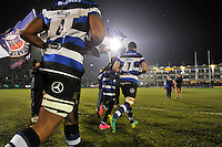 Guy Mercer of Bath Rugby, mascot in hand, leads his team out onto the field. Anglo-Welsh Cup match, between Bath Rugby and Gloucester Rugby on January 27, 2017 at the Recreation Ground in Bath, England. Photo by: Patrick Khachfe / Onside Images