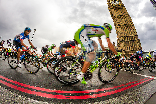 The peleton including Maciej Bodnar (POL) Cannondale pass the Houses of Parliment Westminster near the end of Stage 3 of the 2014 Tour de France running 155km from Cambridge to London. 7th July 2014.<br /> Picture:Thomas Van Bracht/Peleton Photos/www.newsfile.ie