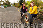Local resident Josephine Bradley, owner of the car that was damaged by a pothole near Ballyseede Graveyard on Monday morning standing with Joan Reidy who helped her at the site of the pothole.