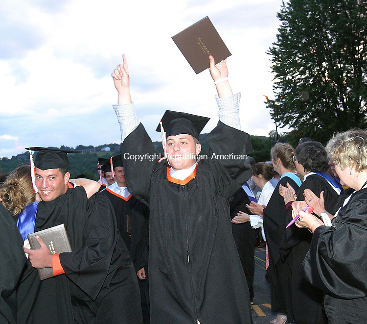 WATERTOWN, CT - 22 June 2005- 062205BZ05- Erik Rinaldi throws his hands in the air to celebrate moments after commencement excercises ended at Watertown High School Wednesday night.<br /> Jamison C. Bazinet Photo