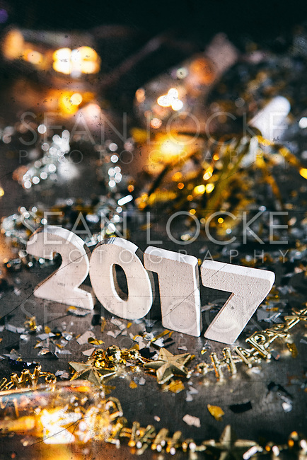 """Gritty images featuring """"2017"""" with decorations, confetti, and more.  Space for copy."""