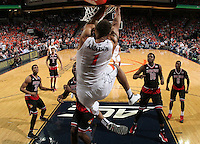 Louisville defenders watch as Virginia guard Justin Anderson (1) dunks the ball in front of them during the second half of an NCAA basketball game Saturday Feb. 7, 2015, in Charlottesville, Va. Virginia defeated Louisville  52-47. (Photo/Andrew Shurtleff)