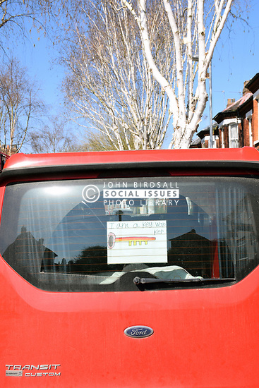 Key worker sign on van in Norwich on day 4 of the Coronavirus pandemic lock down, UK March 2020