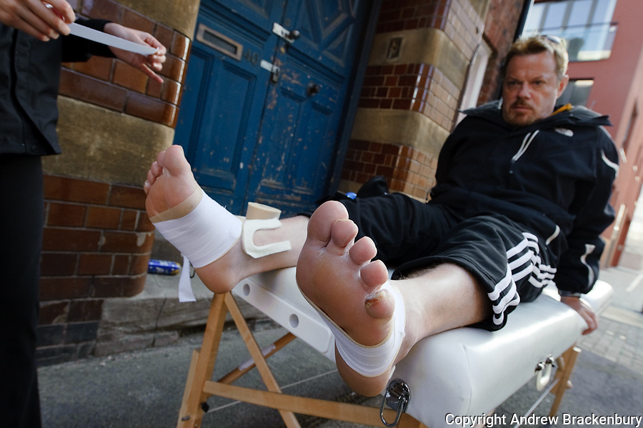 Eddie Izzard's feet show the strain and pain involved in running 43 marathons in 51 days for Sports Relief - image taken in Leicester for Time Out Magazine