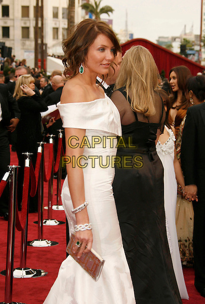 CAMERON DIAZ.The 79th Annual Academy Awards - Arrivals held at the Kodak Theatre, Hollywood, California, USA,.25 February 2007..oscars red carpet half length white off the shulder dress green dangly earrings ring bracelet jewellery.CAP/ADM/RE.©Russ Elliot/AdMedia/Capital Pictures.